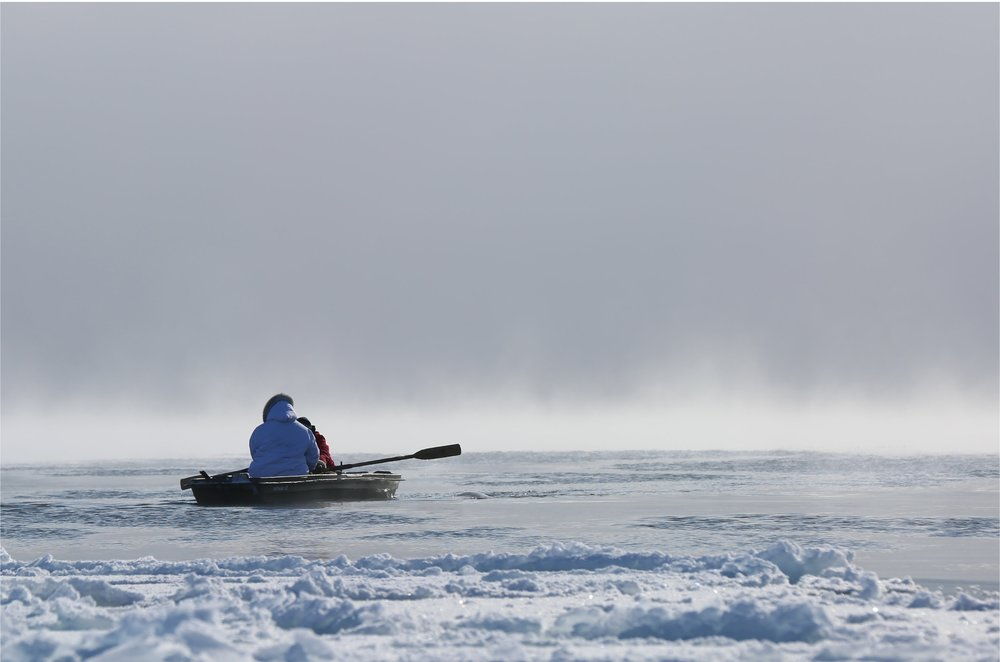 Angry Inuk:  Isuaqtuq Ikkidluak out on the seal ice while seal hunting.