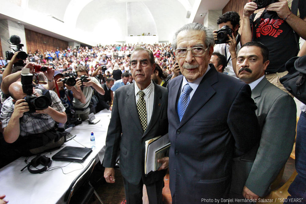 In  500 Years , former dictator General Ríos Montt with his defense attorneys arrive to hear the verdict in his case.