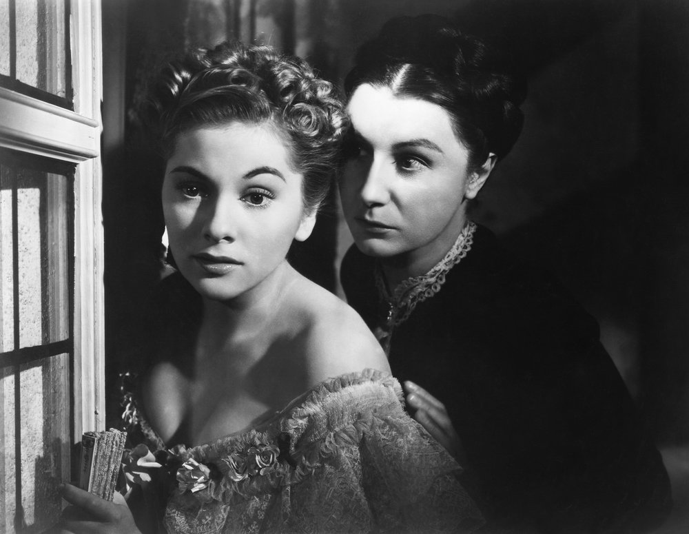 Mrs. Danvers (Judith Anderson), obsessed with the late Rebecca, tries to coax the second Mrs. de Winter (Joan Fontaine) into committing suicide.
