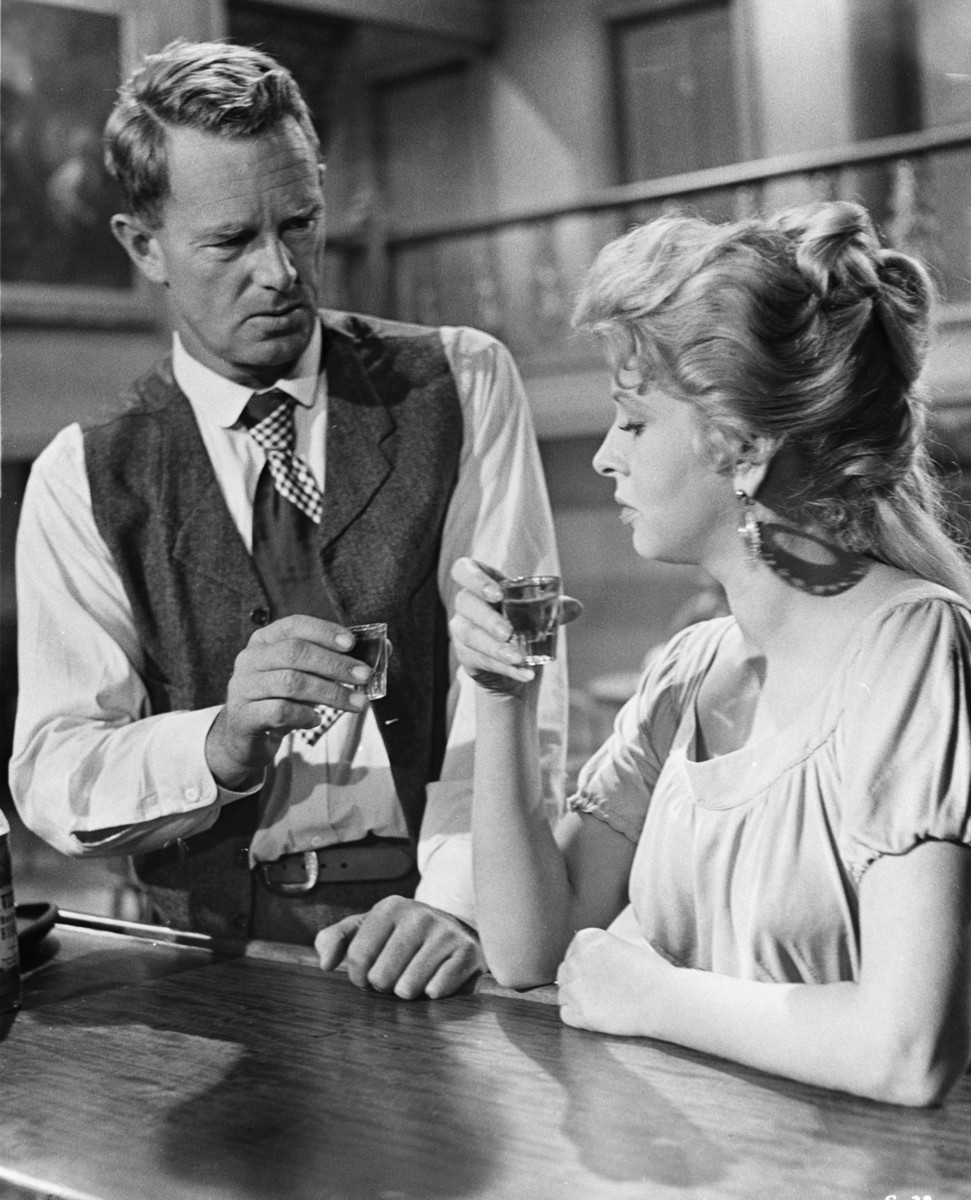 George Hansen (Sterling Hayden) has a drink with Molly (Carol Kelly) in a long monologue scene.