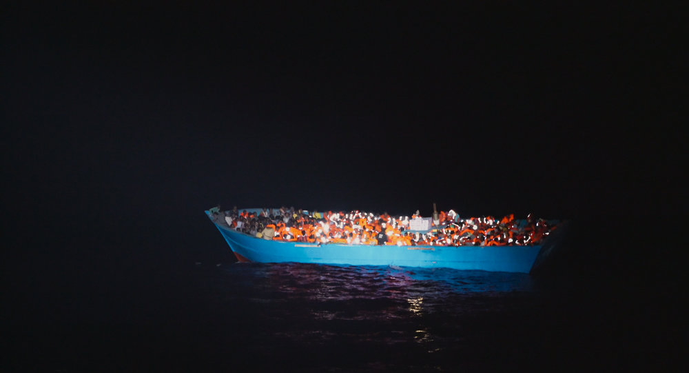 A refugee boat crossing the Mediterranean Sea.