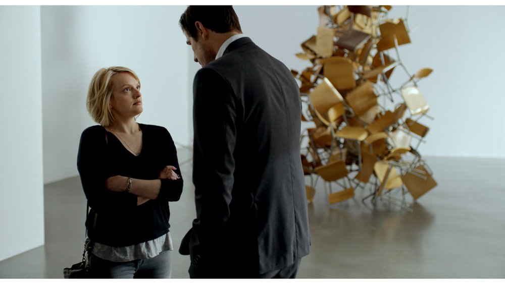 Elisabeth Moss and Claes Bang.