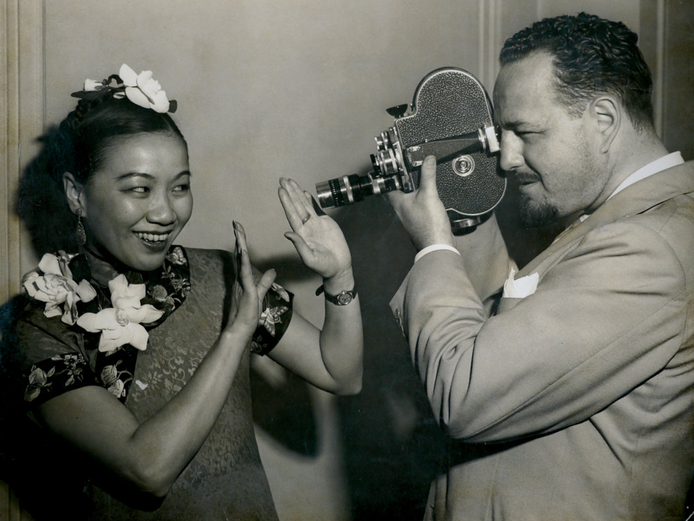 The two forces behind the wartime documentary  Kukan  (1941), Chinese-American multi-hypenate Li Ling-Ai and newsreel cameraman Rey Scott.