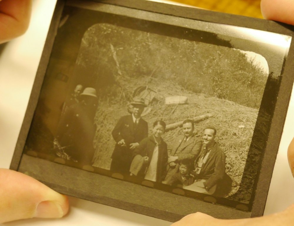 Newsreel cameraman Rey Scott (right), on the scene in war-torn China, in a frame enlargement from  Kukan .