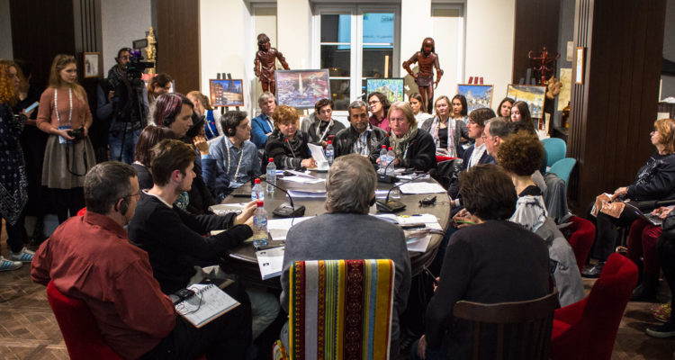 The FIPRESCI Colloquium on Russian Cinema concluded with a roundtable discussion at Lenfilm Studios (Godfrey Cheshire, in white scarf, is speaking at the far end of the table).