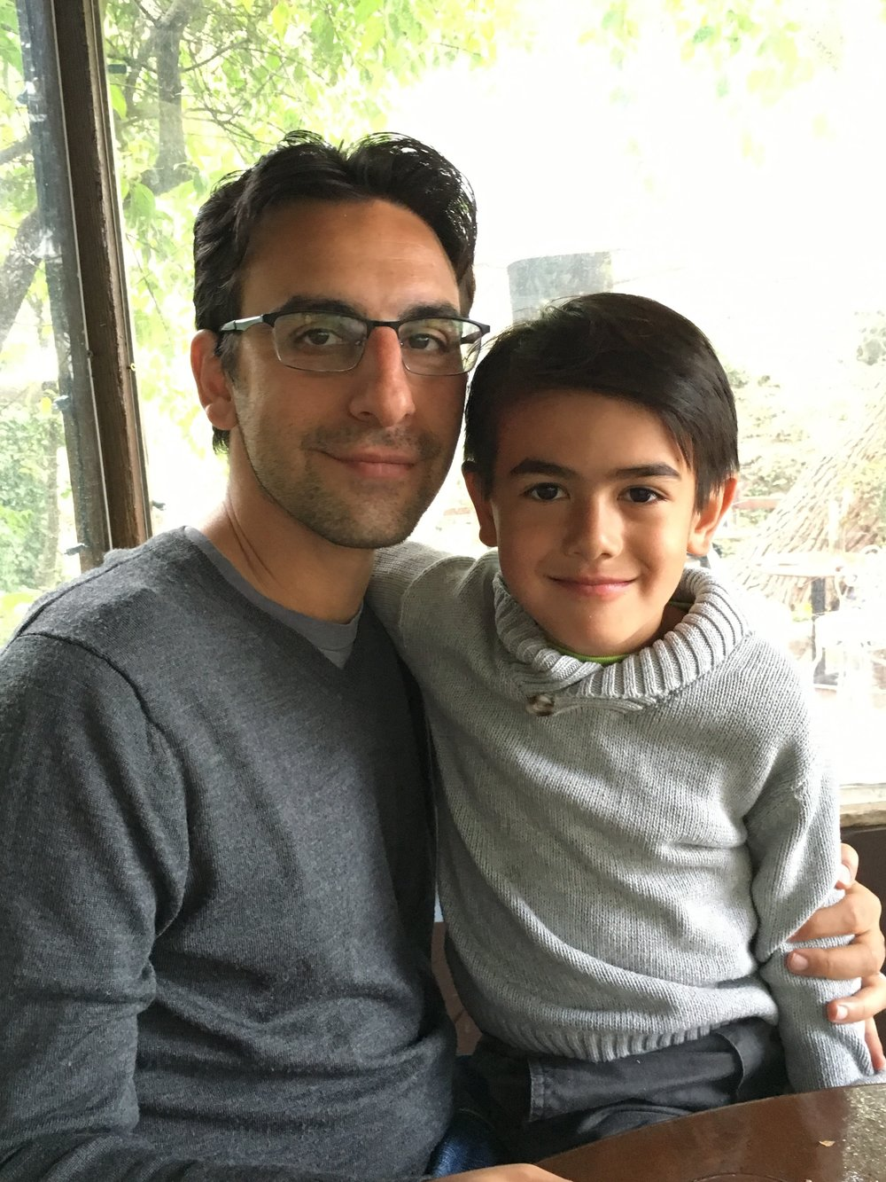 The author, Nafis Shafizadeh, and his four-year-old son Kamil.