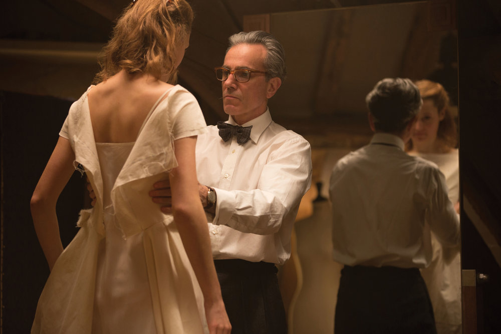 Fashion designer Reynolds Woodcock (Daniel Day-Lewis) fits a dress on muse Alma (Vicky Krieps) in an early scene.
