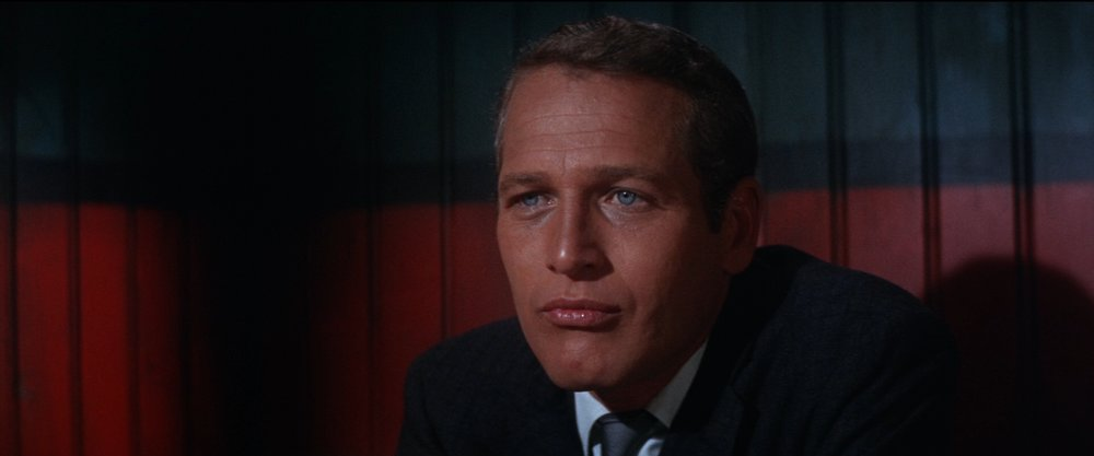 Lew Harper (Paul Newman) ponders one of the many criminal mysteries that occur during  Harper  and  The Drowning Pool .