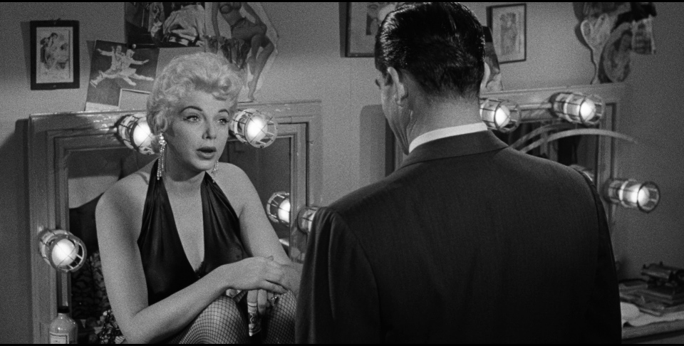 Like the audience, stripper Dolly Moore (Barbara Nichols) doesn't know who she's dealing with in  Beyond a Reasonable Doubt.
