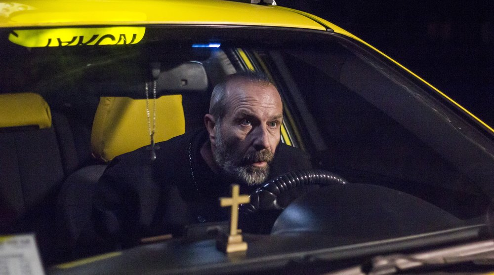 The priest taxi driver in Komandarev's  Directions.