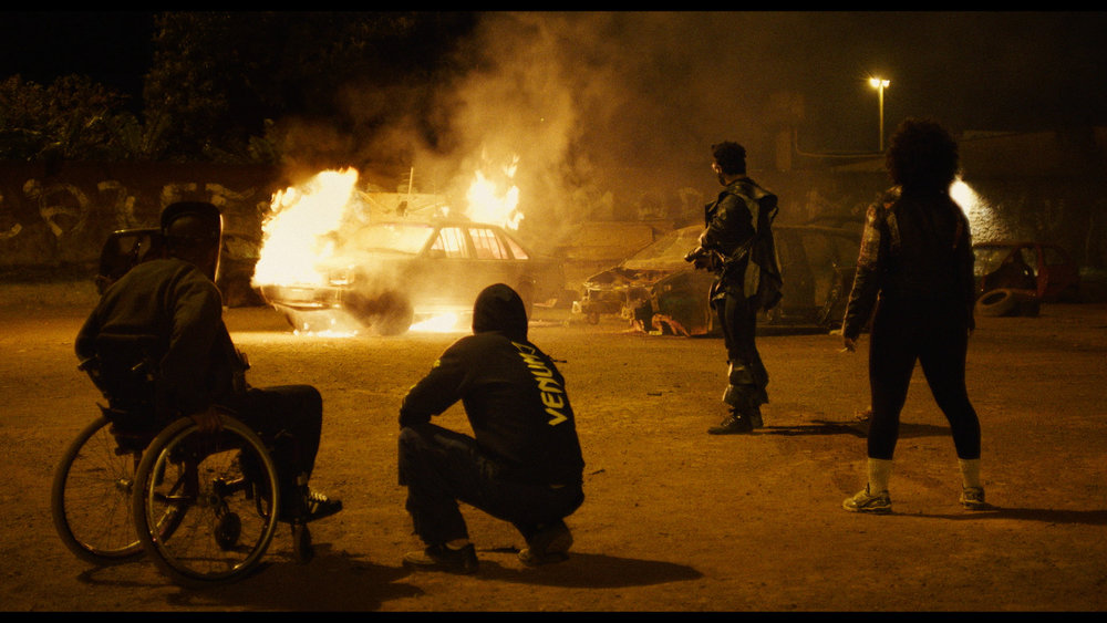 Moment of Catharsis - future warriors burn a car on the site of the spaceship crash