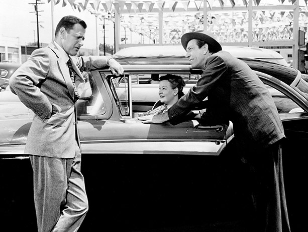 A used-car salesman (Tony Randall) uses the hard sell on a couple that can't really afford his wares.