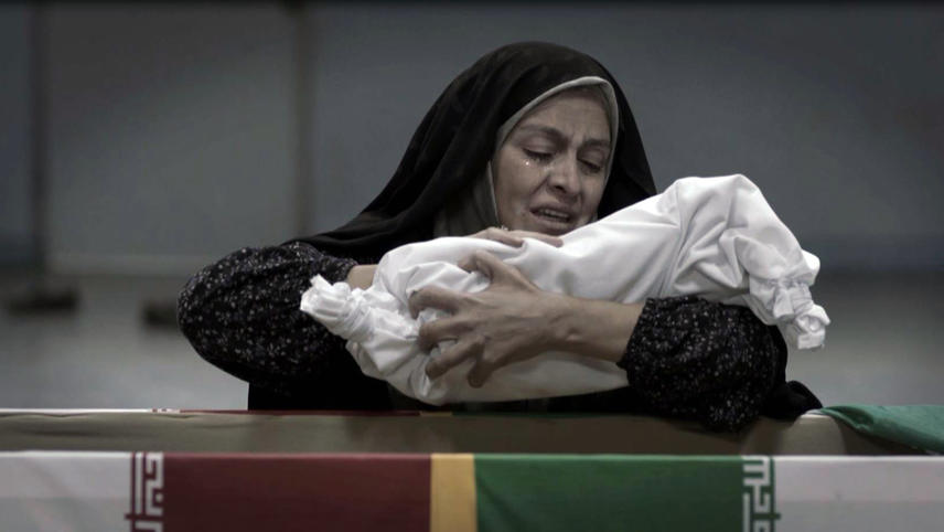 In the final and symbolic scene of  Track 143 , Olfat, played by Merila Zare'i, collects the bones of his martyred son after fifteen-years of waiting for him to return home from the eight-year-long Iran-Iraq war.