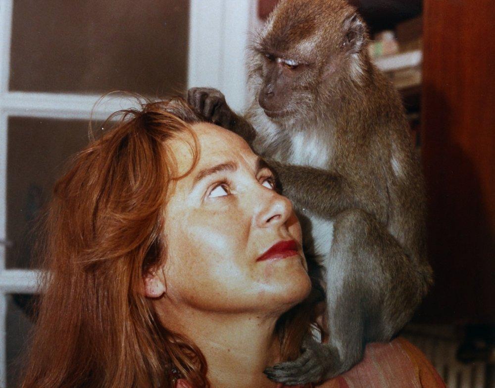 An ornery pet monkey pesters Julita Salmerón in  Lots of Kids, a Monkey and a Castle.