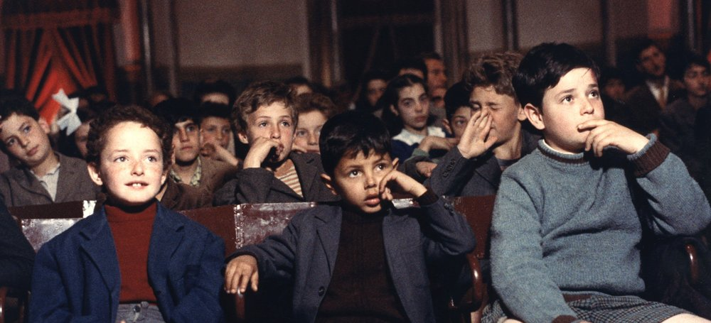 Salvatore (Salvatore Cascio, center) is one of many entranced youngsters who attend screenings at the local cinema in Guiseppe Tornatore's  Cinema Paradiso .