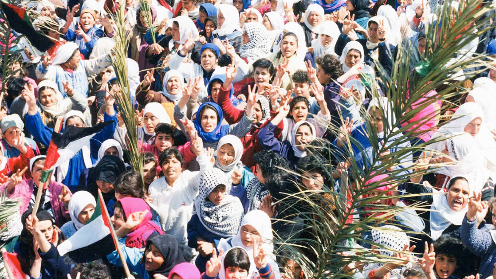 Women demonstrate during the First Intifada in  Naila and the Uprising .