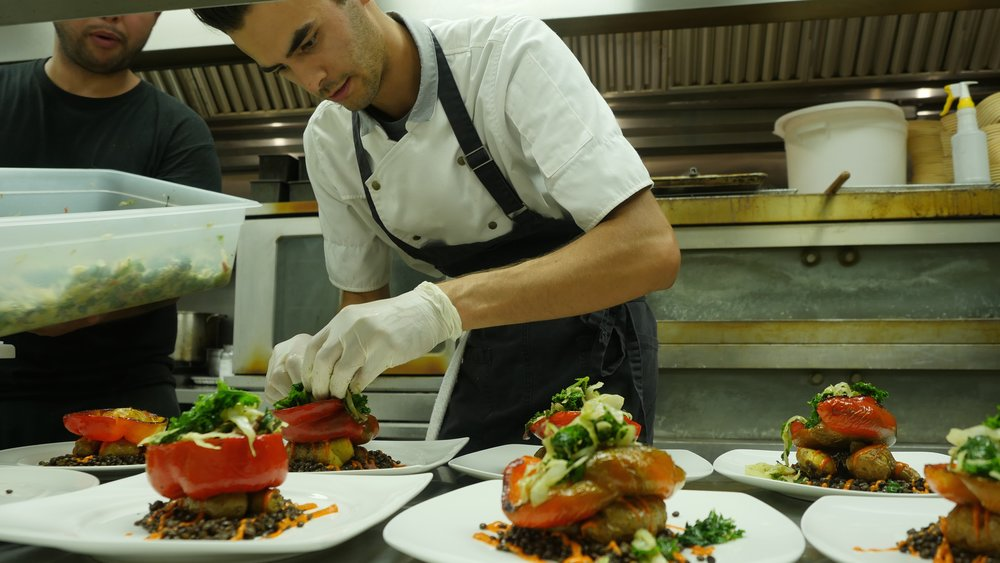Plating the main course of a pop up dinner in Springfield, MO.
