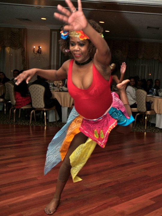 Mikerline Pierre, performing Rara, director of her eponymous Haitian dance company