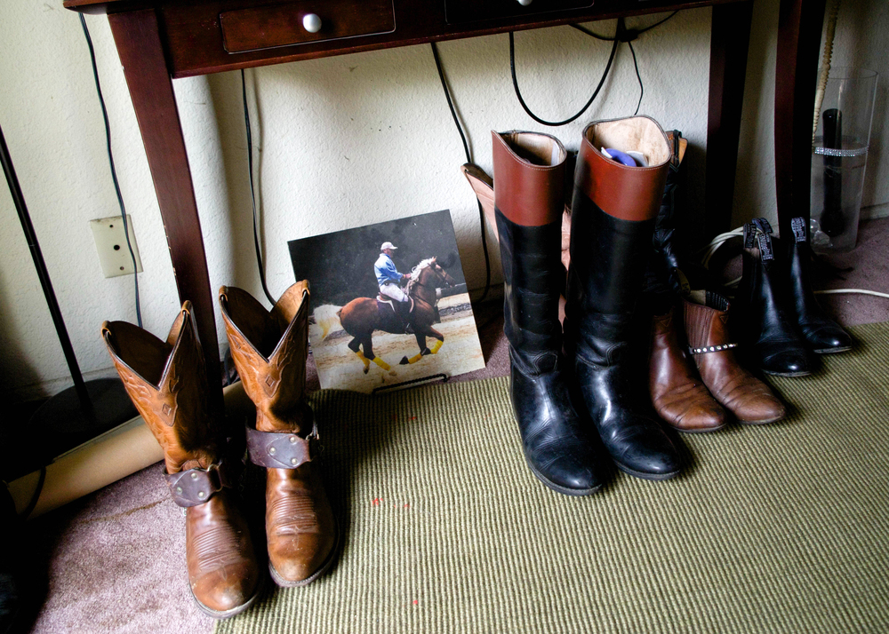 A row of riding boots in Gerry's living room, Hollywood, 2016.