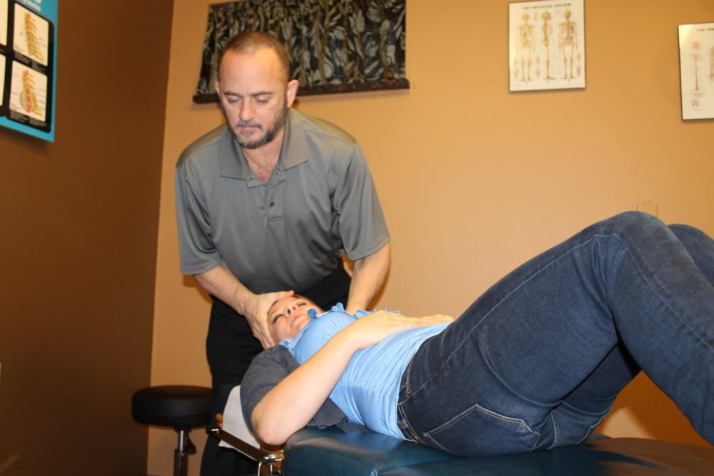 Sciortino, DC, performing spinal manipulation.