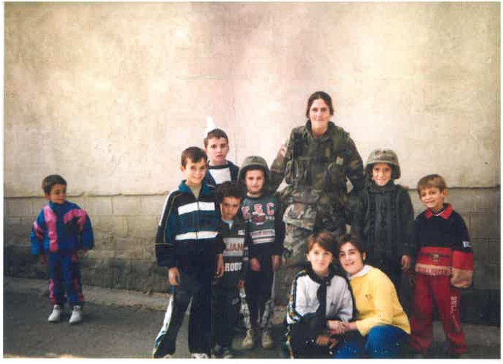 1996 - Meena in Kosovo bringing school supplies to local children after their school had been bombed.