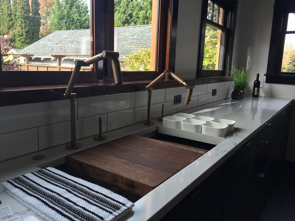 This home in NE had been recently remodeled, and they did a great job with the kitchen. The countertops were beautiful, but I especially loved the wood block insert that extended the counter into the sink.