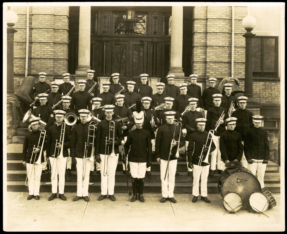 Ohio University's first ever band stands on the steps of Ewing Hall in 1923. The original band of 33 members has grown into today, a group of 200+. (COURTESY OF OHIO UNIVERSITY LIBRARY DIGITAL COLLECTION)