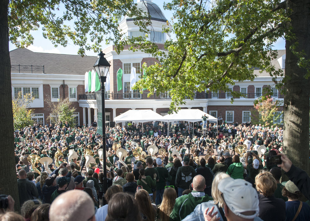 The Marching 110 Alumni band performs in front of Baker Center during the Homecoming Parade. Each year, more than 300 Alumni return to march and perform.