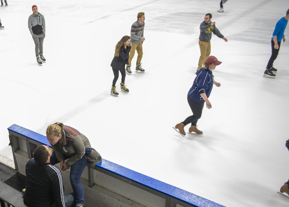 Senior Garrett Birk leans in to kiss his girlfriend Katie Lach while at open skate at Bird Arena. Members of the trombone section often go to Bird to skate together.