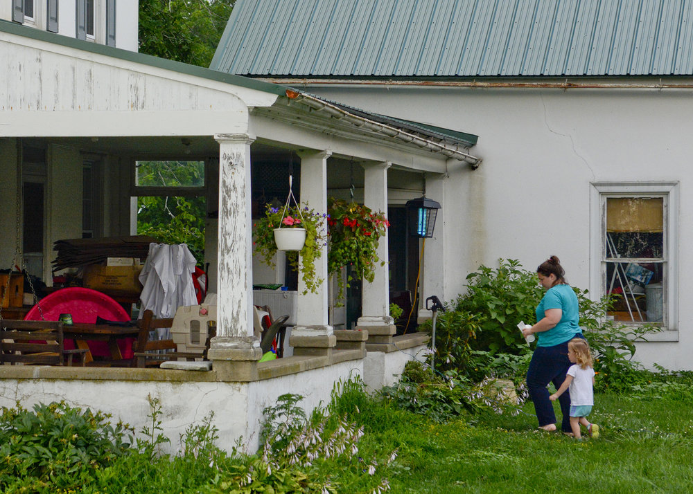 Jodi Gauker and daughter Callie, 2 1/2 of Fleetwood walk into their house at the Gauker Family Farm in Fleetwood on July 18, 2017.