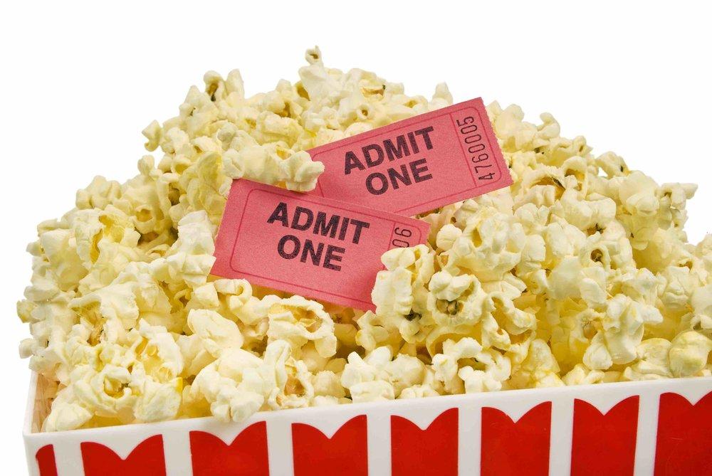 bucket-of-popcorn-with-movie-tickets_Htxx0uap4i.jpg