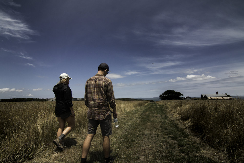 Naturaliste tours - couple walking in grass.jpg