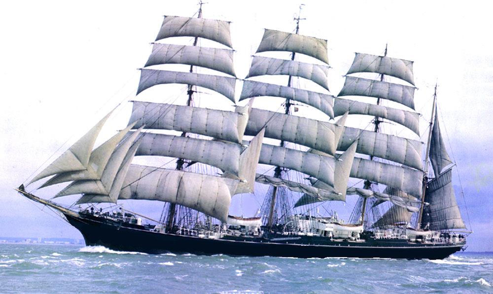 A four-masted barque under sail.