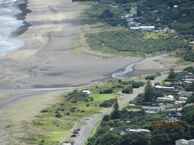 Figures 5a and b: Photographs of the joined Wekatahi and Marawhara Streams, North Piha. Note the proximity of the Wekatahi Stream to the road in the lower right corner of the image 5b.