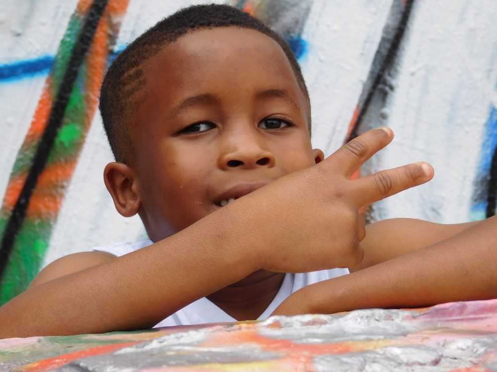 Kid Throwing A Sign
