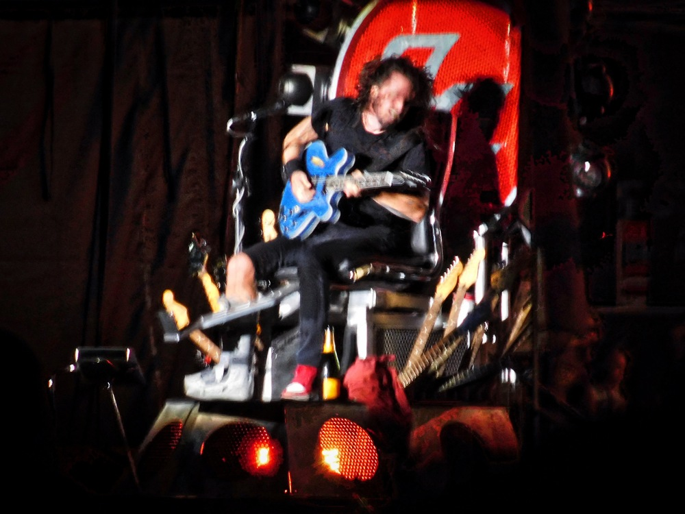 My best zoomed in shot of Foo Fighters leader Dave Grohl. He sat on a throne surrounded by guitars due to a broken leg sustained earlier in the year.