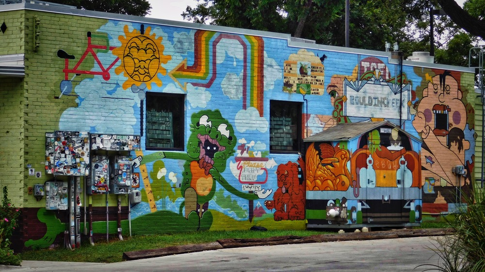 Very colorful mural behind the  Bouldin Creek Cafe .