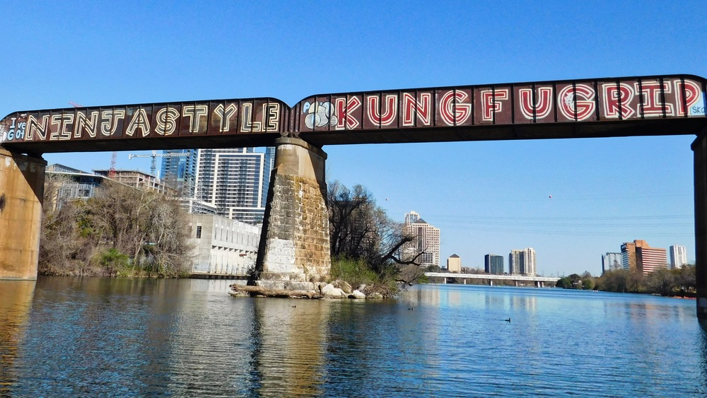 Downtown railroad bridge graffiti. Just to the right of this, but not pictured, is Pac Man themed graffiti.