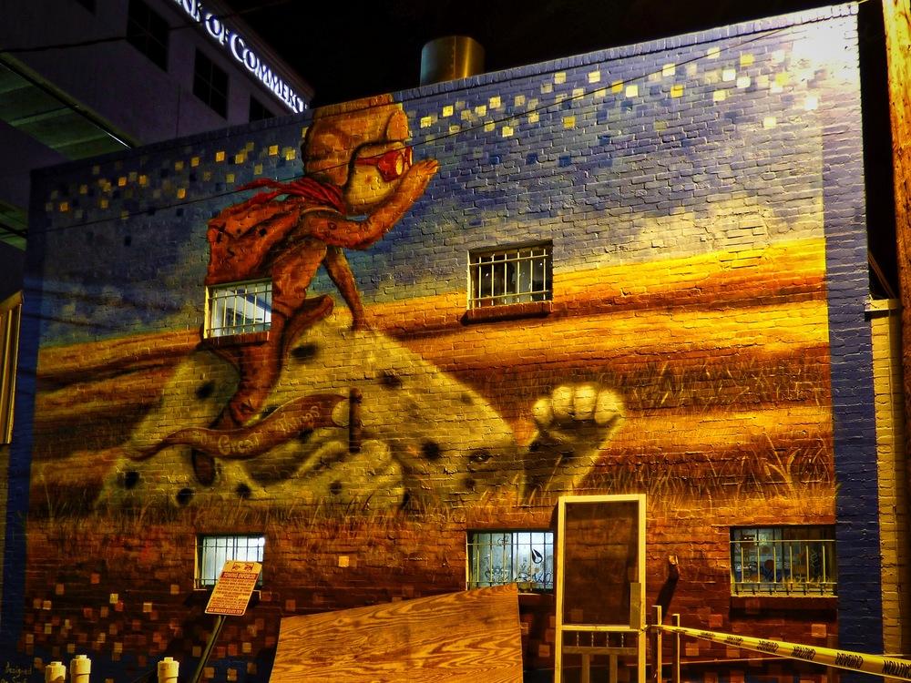 Mural by  Lucas Aoki  behind  Wahoo's Fish Taco  on Rio Grande near West Sixth Street.
