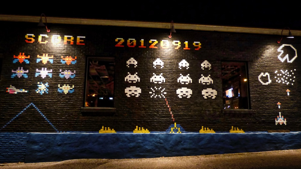 80s video game themed mural on the side of  Kung Fu Saloon .