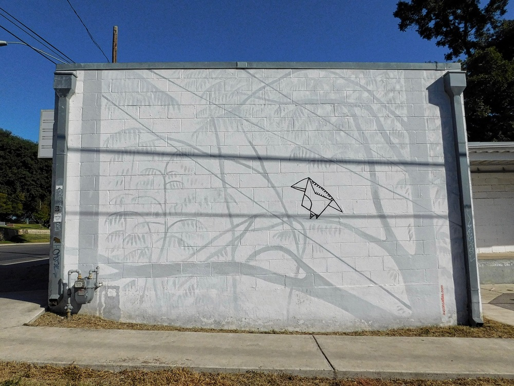 This mural located at the corner of East 7th St and Navasota depicts the shadow that falls on the wall at night.