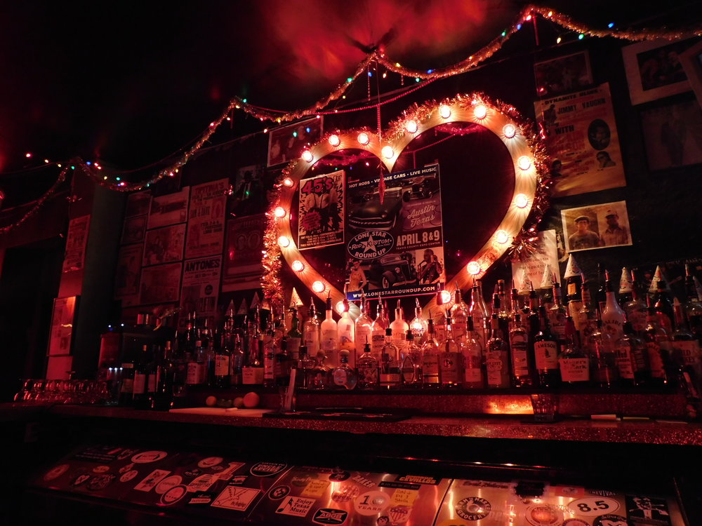 A couple of blocks south of Your Essential Magnificence at 2008 South Congress you'll find throwback music joint C-Boy's Heart & Soul. The interior is super red with a strong lounge vibe and this red heart of lights behind the bar.
