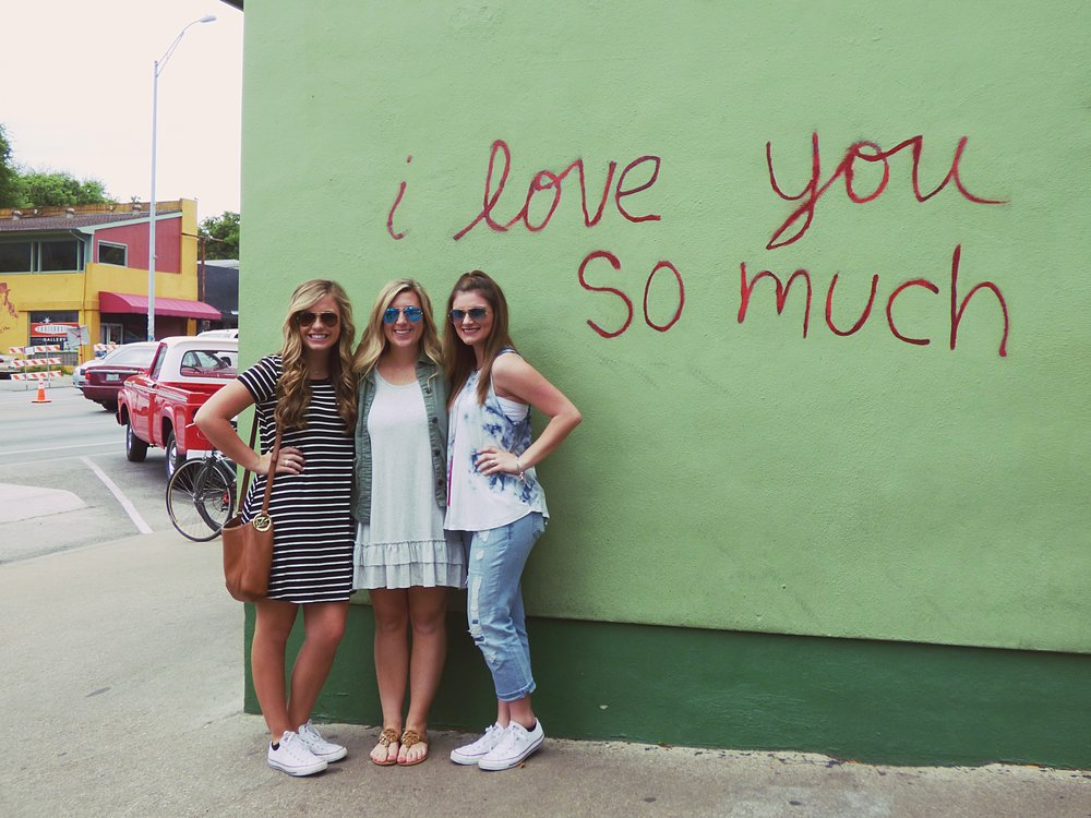 """Jo's Coffee at 1300 South Congress has hot coffee and good tacos but just as many people come to post in front of the """"I love you so much"""" graffiti on the side of the building."""