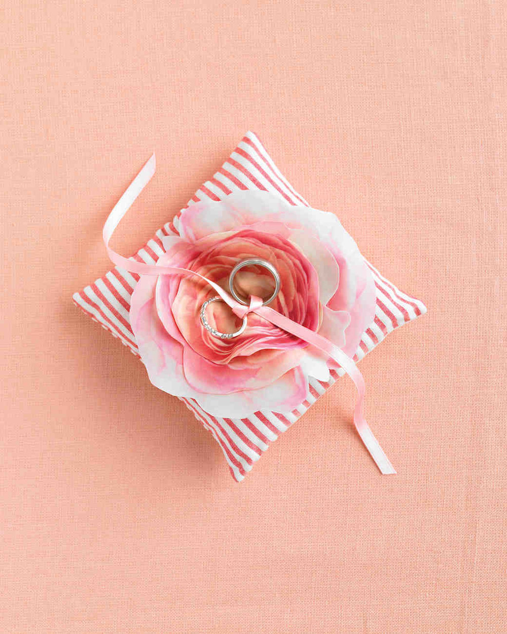 FABRIC FLOWER RING PILLOW  - With our striking trompe l'oeil floral print as clip art, this fabric flower looks just like the real thing. Photography:  Raymond Hom