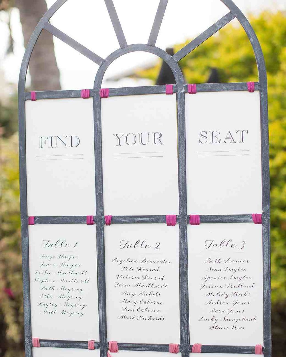 Calligraphed Seating Chart This bright, tropical wedding had a classic touch, thanks to this white and pink seating chart calligraphed by Miss B Calligraphy. Photography: Kathleen Geiberger Art