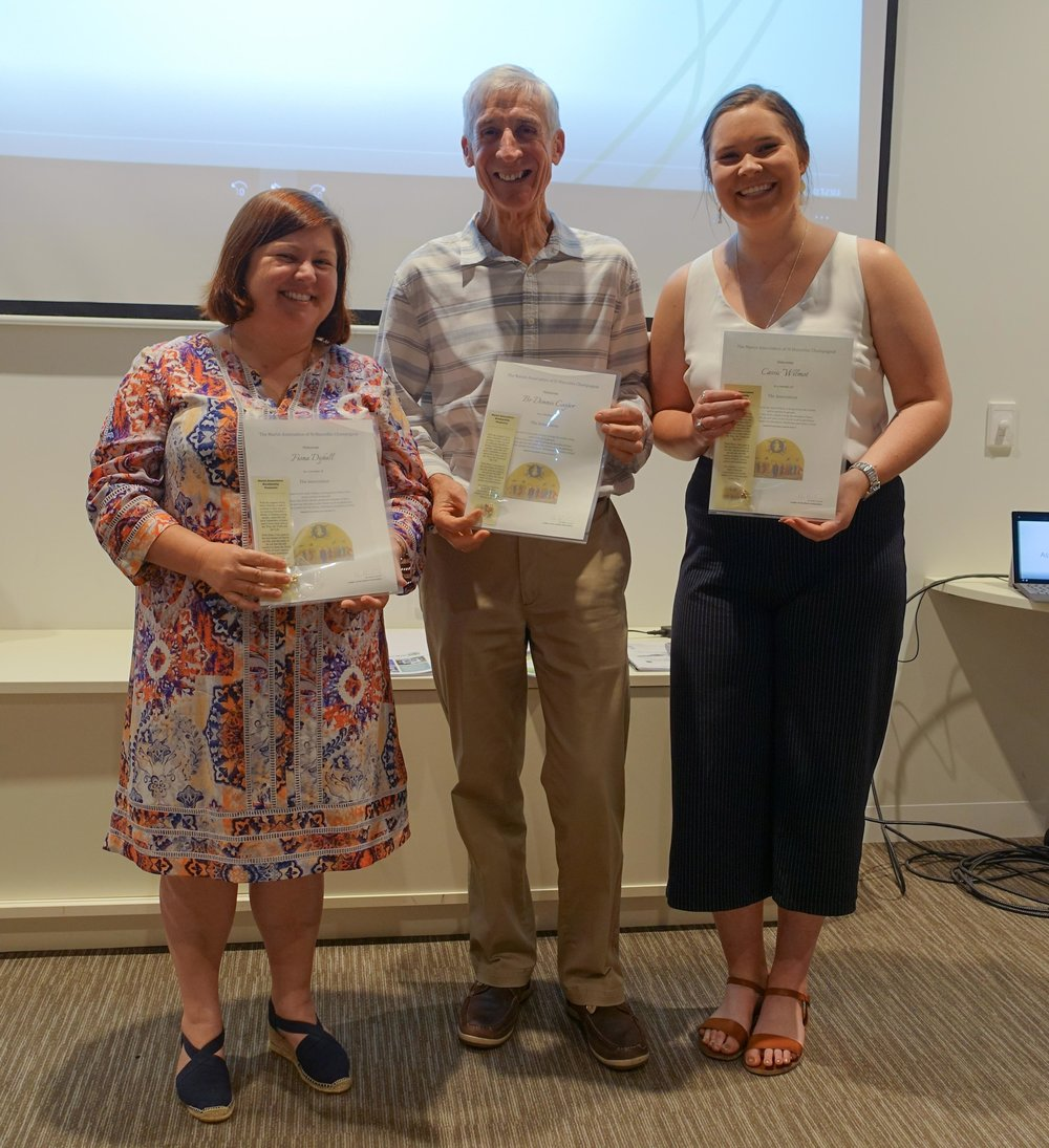 Fiona , Br. Dennis, and Cassie receiving their certificates