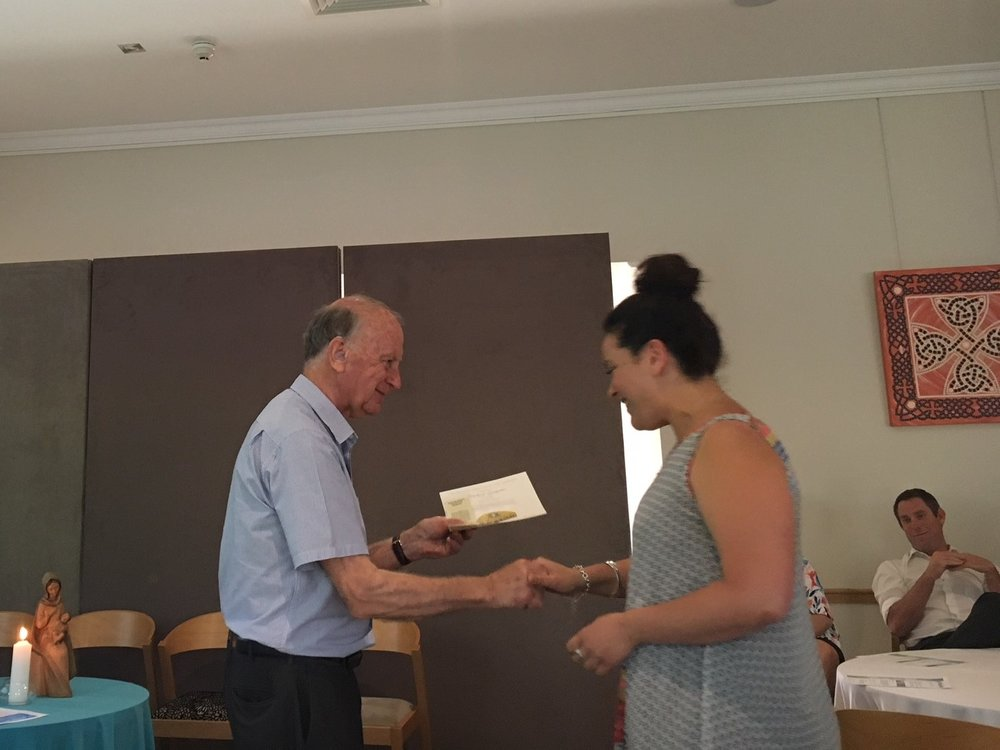 Br John Horgan presents Melissa Gangemi with her membership certificate.