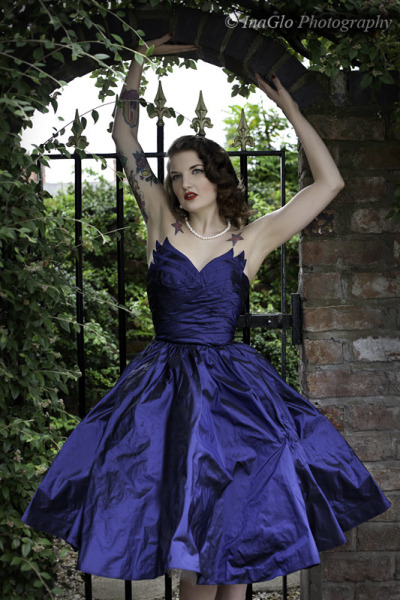 wearing a dark blue wedding dress.jpg