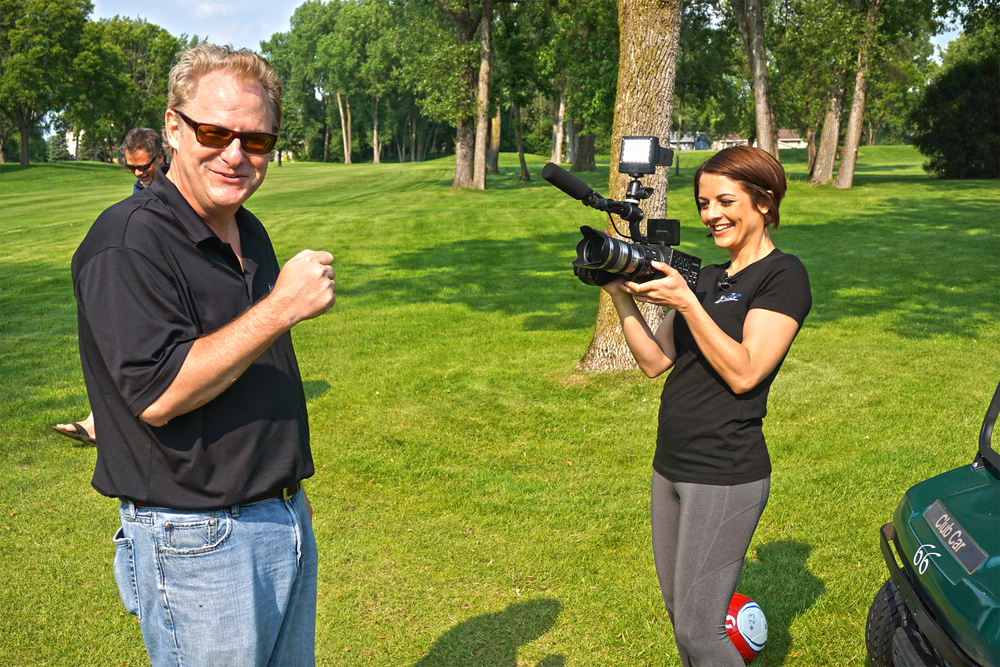 Some role reversal fun as show creator and co-executive producer John McCally and host Jennifer Mergen switch places while filming.