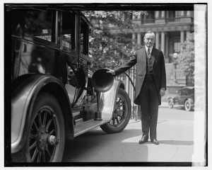 Calvin Coolidge next to car with megaphone